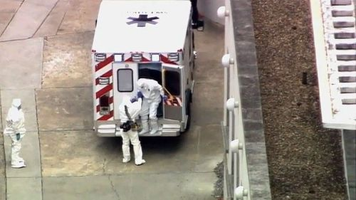 An ambulance arrives with Ebola victim Dr. Kent Brantly, right, to Emory University Hospital. (AP Photo/WSB-TV Atlanta)