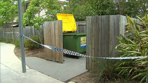 Police found a body in the bin of the Yaronga apartment complex on Saturday night.