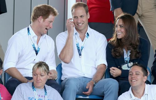 Prince Harry, Prince William and Catherine, Duchess of Cambridge, sit in the stands during events at the Glasgow Commonwealth Games.