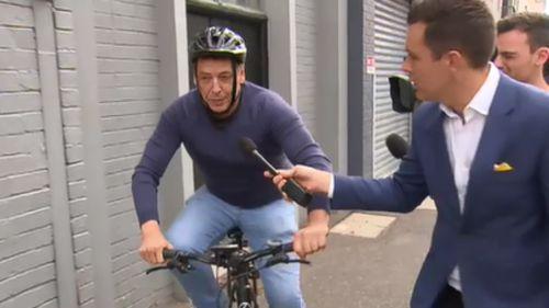 """I'm sorry,"" the ex-Essendon coach said as he rode away on his push-bike. (9NEWS)"