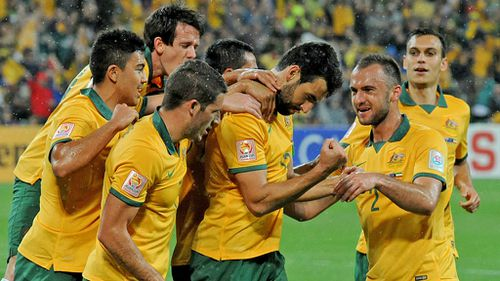 Socceroos captain Mile Jedinak (centre) celebrates after scoring a goal in the win over Kuwait. (AAP)