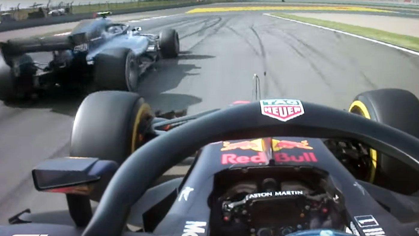 Daniel Ricciardo burns Bottas