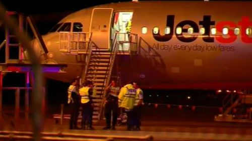 Jetstar flight forced to make emergency landing in Newcastle after smoke spotted in bathroom