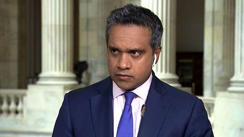 CNN political reporter Manu Raju with a cicada on his lapel.