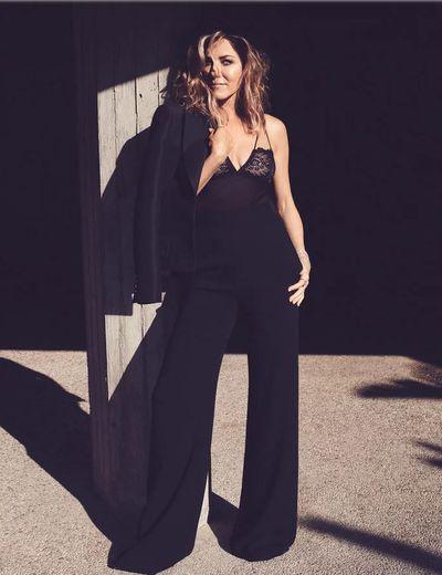 <p>Jennifer Aniston forUS <em>InStyle,</em> September 2018</p> <p>The actress wears a Louis Vuitton blazer, Brandon Maxwell pants, Lonely Label bodysuit, Van Cleef & Arpels bracelet and Chopard rings and bracelet.</p>