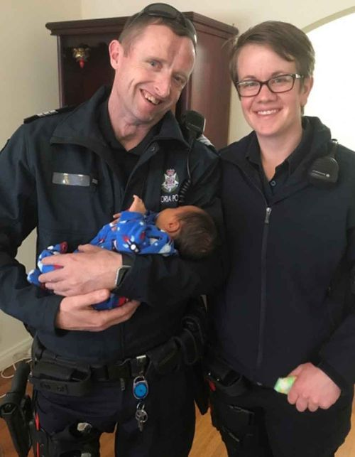 The officers with little Ryder. (Victoria Police)