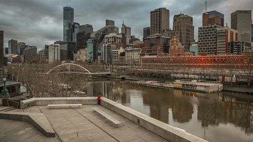 A lone man is seen looking out towards the Yarra river in Southbank in Melbourne, Australia.