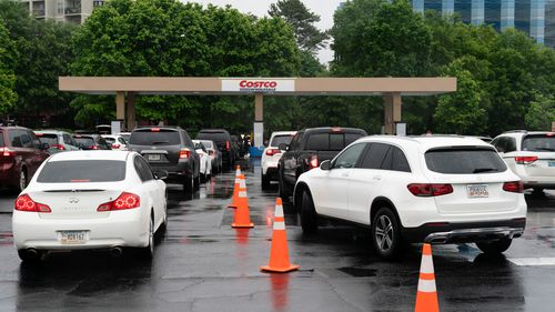 Drivers wait in line to refuel vehicles at a Costco Wholesale Corp. gas station in Dunwoody, Georgia last week.