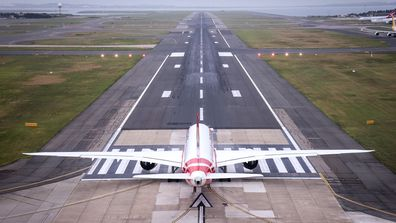 A Boeing 787 Dreamliner aircraft, Qantas flight QF100, prepares to take off from Kingsford Smith International airport.