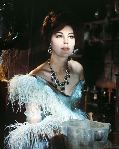 Gardner in period costume with an ornate necklace in a publicity portrait issued for the film, '55 Days at Peking', 1963.