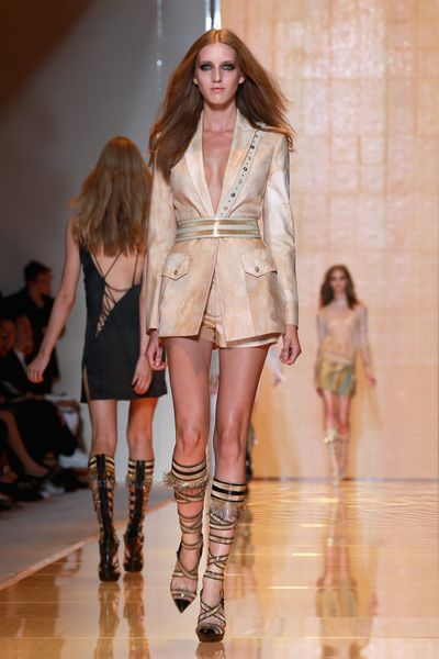 "<p><strong>Classic inspiration:&nbsp;</strong>Versace Spring/Summer 2013, Milan  Fashion Week on September 21, 2012.</p> <p><strong>Buy:</strong>&nbsp;Versace runway boots spring 2013, approx. $769.60 at<a href=""https://www.vestiairecollective.com/women-shoes/boots/versace/beige-leather-versace-boots-4819434.shtml"" target=""_blank"" draggable=""false""> Vestiaire Collective</a></p>"