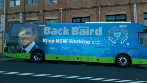 'It is the city of the arts': NSW Premier laughs off graffiti attack on campaign bus