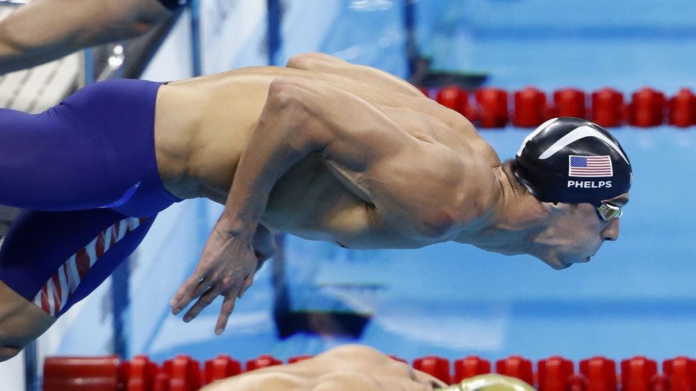 Michael Phelps takes off for his 22nd gold medal. (AFP)