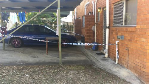 A man was arrested at a nearby unit, where neighbours described hearing an argument.
