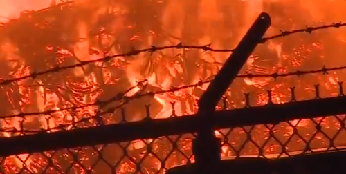 An intense blaze at a Jim Beam warehouse in Kentucky has sent flames flying into the night sky.