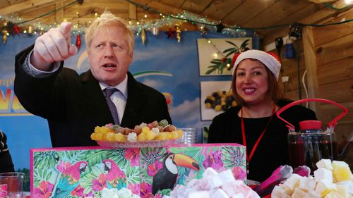 Prime Minister Boris Johnson visits a Christmas market whilst campaigning on December 3, 2019 in Salisbury, England.