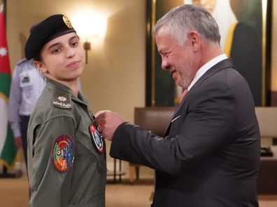 His Majesty King Abdullah II, Supreme Commander of the #Jordan Armed Forces, presents HRH Princess Salma bint Abdullah II with her wings after completing pilot training.
