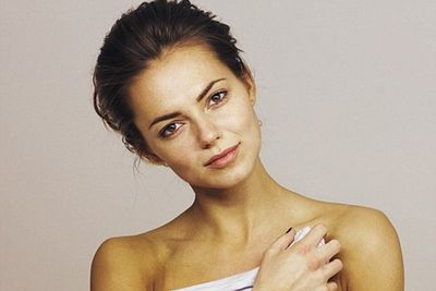 """The UK actress said she felt """"ridiculously naked"""" when she posed for this photo… maybe her lashes are naturally dark and luscious! (Image: <i>Heat</i> magazine)"""