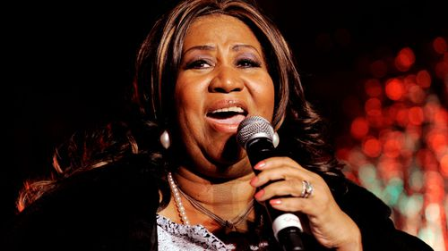 Aretha Franklin performs during the lighting ceremony of the Christmas tree outside the New York Stock Exchange in 2008.