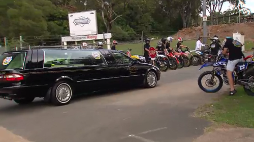 """Mr Gordon, affectionately known as """"Knuckles"""", was today escorted by a roar of engines as a motorcade of friends on Harley motorbikes accompanied him on his final trip past his Nerang High School."""