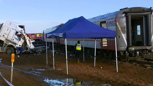 The operation to recover the train and damaged truck is expected to keep the line closed for four days. (9NEWS)