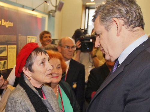 British Prime Minister Gordon Brown, right, meets with former child migrant Mary Johnston at Westminster, in London, on Wednesday Feb. 24, 2010. Prime Minister Gordon Brown has made an official apology to the many thousands of poor British children who were sent to former British colonies such as Australia, where many are known to have suffered terrible abuses.