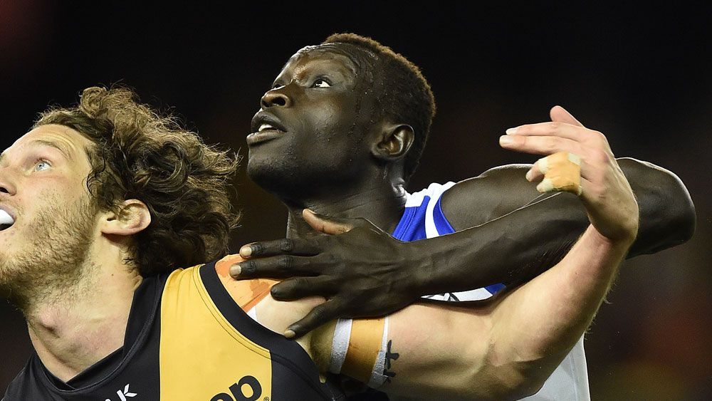 Majak Daw will be retained through the AFL rookie draft. (AAP)