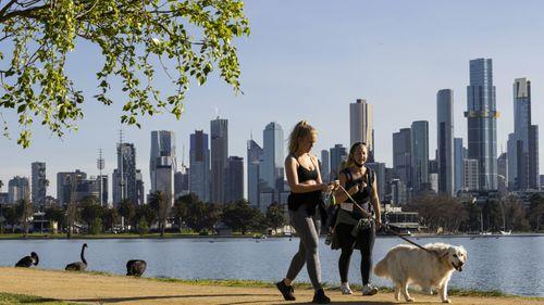 People exercising at Albert Park Lake in Melbourne.
