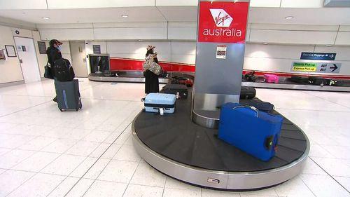 Passengers from Adelaide flight arrive in Sydney.