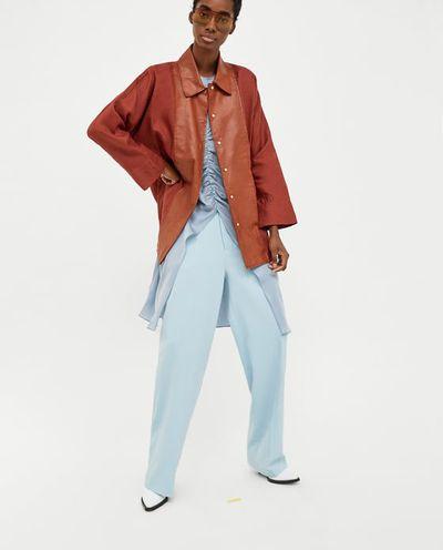 """<a href=""""https://www.zara.com/au/en/contrasting-leather-and-linen-jacket-p02761053.html?v1=6141046&v2=1009504"""" target=""""_blank"""" draggable=""""false"""">Zara Contrasting Leather and Linen Jacket in Brandy, $179</a>"""