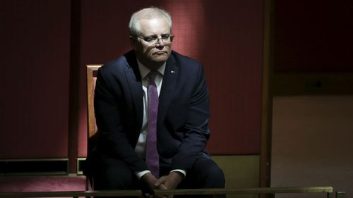 Scott Morrison listens to Mathias Cormann's farewell speech to the Senate.