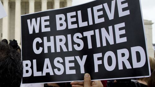 Protesters demonstrate in opposition to Brett Kavanaugh's nomination by supporting his alleged attempted rape victim Christine Blasey Ford.