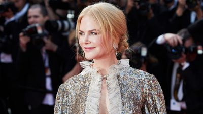 Nicole Kidman walks the red carpet at the Cannes Film Festival 2017 wearing a silver sequined dress with matching metalic heels.