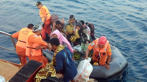 Indonesian Search and Rescue (Basarnas) evacuate residents from smaller islands after an earthquake struck in North Lombok