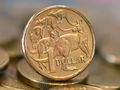 Aussie dollar trades lower over US property fears
