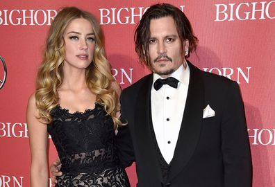 FILE - In this Jan. 2, 2016 file photo, Amber Heard, left, and Johnny Depp arrive at the 27th annual Palm Springs International Film Festival Awards Gala in Palm Springs, Calif. A Los Angeles Superior Court spokeswoman says the temporary restraining order Heard obtained against Depp will remain in effect until Aug. 15. Court records show Heard filed for divorce in Los Angeles Superior Court on May 23, 2016, citing irreconcilable differences. The pair were married in February 2015 and have no chi