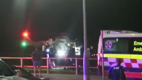 The rescue helicopter lands with the two divers on a Sydney beach where the women were treated by paaramedics.