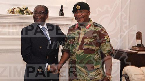 President Mugabe chats with ZDF Commander General Constantino Chiwenga. (The Herald)