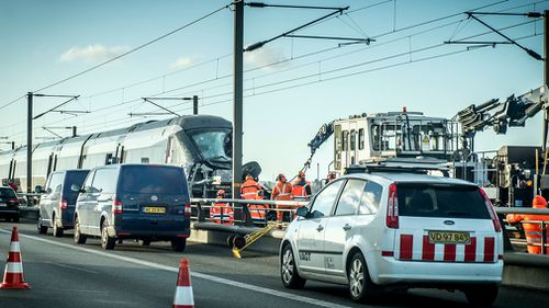 The company that maintains and controls rail network traffic, Banedanmark, said the train was heading towards the capital Copenhagen with 131 passengers when it hit what could have been a tarpaulin or something else from the freight train on the tracks.