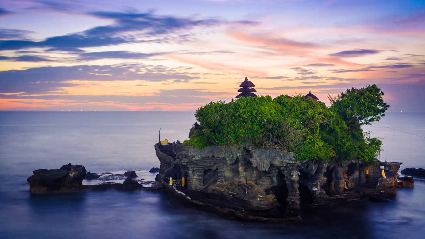 Sunset at Tanah Lot temple on an island, Bali