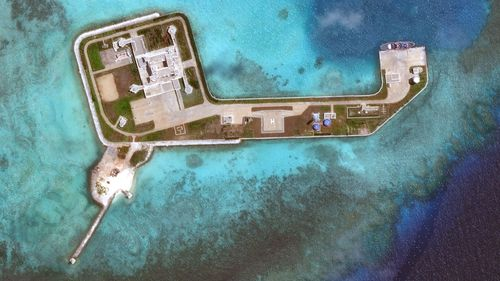 DigitalGlobe overview imagery of one of the Hughes Reefs. The Hughes Reef is located in the Union banks area within the Spratly group of islands in the South China Sea.