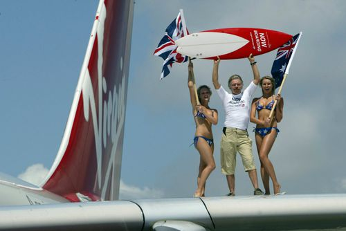Happier days: Sir Richard Branson, Chairman of Virgin Atlantic Airways pictured arriving at Sydney International Airport with the first Virgin Atlantic flight to Australia, in 2004.