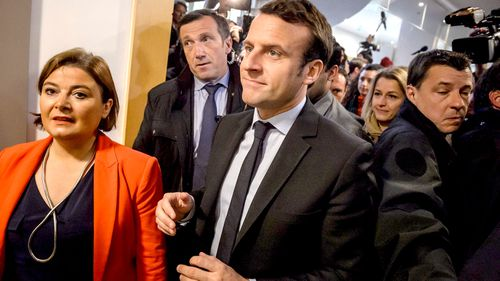 Emmanuel Macron, the favourite to be elected next French president, was already touring the factory when Le Pen arrived. (AAP)