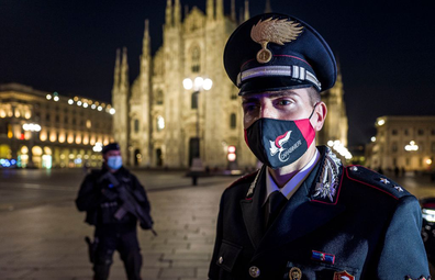 Carabinieri in Piazza Duomo in Milan do compliance checks for new COVID-19 regulations on the first day of lockdown.