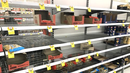 Supermarket shelves emptied of pasta and spaghetti.