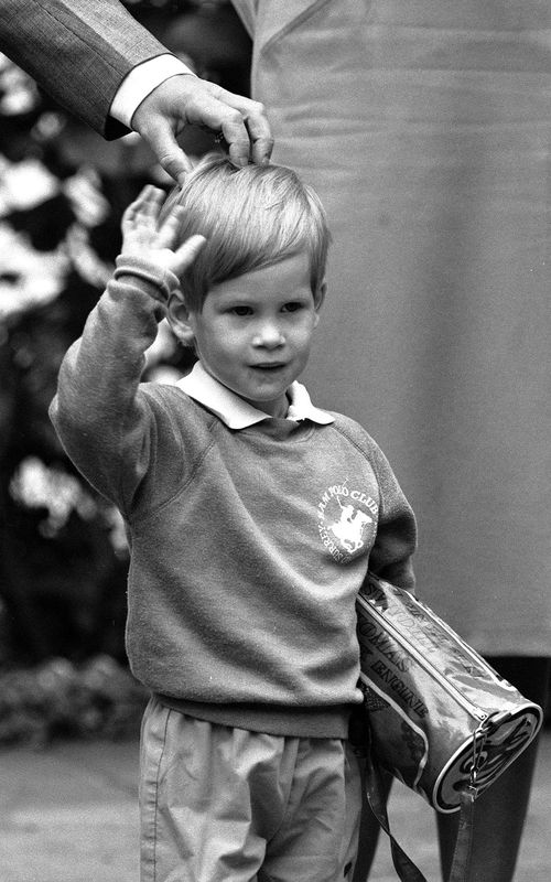 File photo dated from September 16, 1987, of Prince Harry arriving for his first day of nursery school at Chepstow Villas in west London with a Thomas the Tank Engine bag. (AAP)
