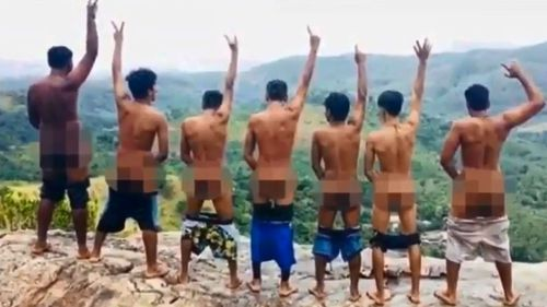 This photo from Sri Lankan police shows a group of men with bare bums on Pidurangala Rock. Three were later arrested by police.