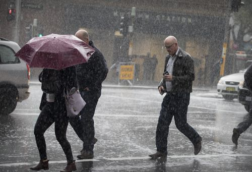 There has been no repreive from the rain for Sydney siders today in the CBD. Picture: AAP