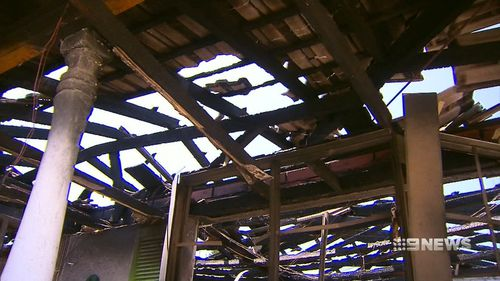 Firefighters had to battle the blaze from outside after the roof started collapsing. (9NEWS)