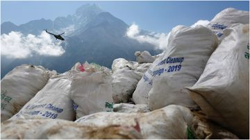 Local cleanup crews are struggling to remove the excess garbage brought to Mount Everest by foreign climbers.